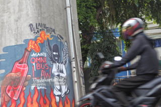 mural tolak UU Cipta Lapangan Kerja